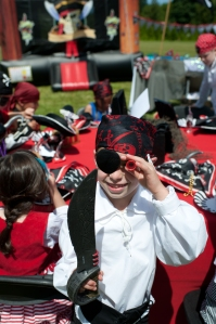 Pirate costume props such as head scarves, eye-patches, swords, and hats were a hit at this Pirate Themed birthday without breaking the bank.